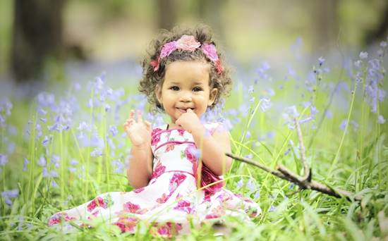 Beautiful Baby Girl Surrounded By Bluebells